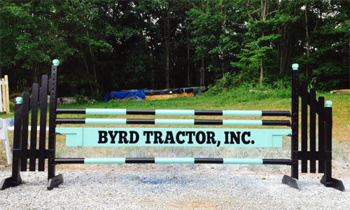 Byrd Tractor sponsored horse jump with Dapple Equine horse jump cups