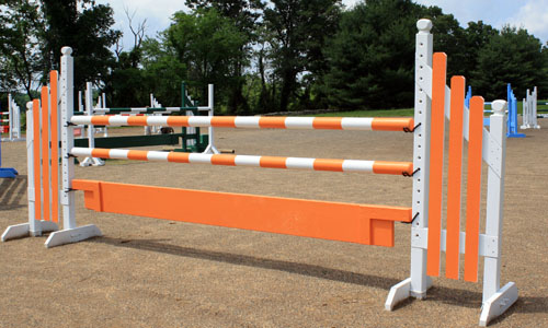 orange and white horse jump with Dapple Equine horse jump cups