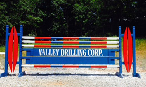 Valley Drilling sponsored horse jump with Dapple Equine horse jump cups